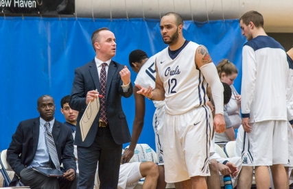 Coach Michael Donnelly talks to Tylon Smith before heading back on the court.