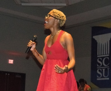 Judean Brown singing for her performance.