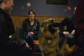 Lauren Defoe (left) with Moose and Christian Deskin, sports management major. Photo Credit, Tyler Korponai