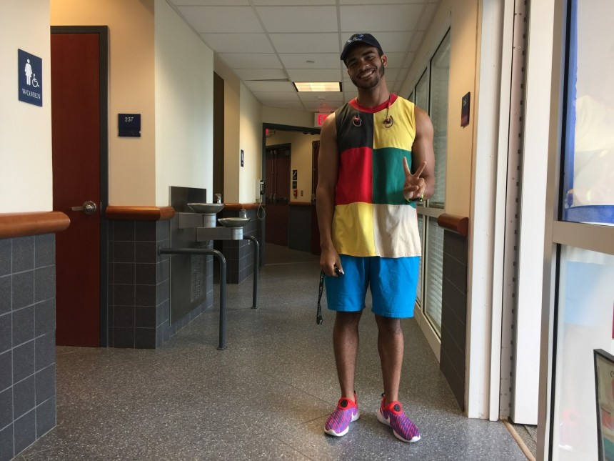 Sammy Maximin,  senior business finance major, outfitted in his favorite style: bright clothing which matches his mood.