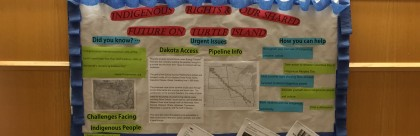A board in Engleman Hall giving information about Native American rights and explaining the Dakota Access Pipeline.