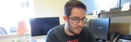 Human of SCSU, Ryan Meyer, typing away on his computer.