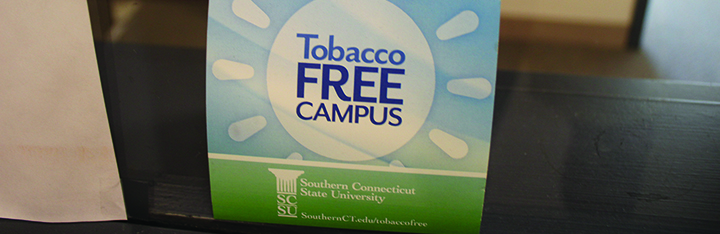 A tobacco-free campus sign reminds student, faculty and visitors of the policy against smoking, Oct. 17, 2016. Photo Credit: Palmer Piana